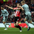 Sunderland's Seb Larsson, left, vies for the ball with Burnley's Ben Mee, right, during their English Premier League soccer match between Sunderland and Burnley at the Stadium of Light, Sunderland, England, Saturday, Jan. 31, 2015