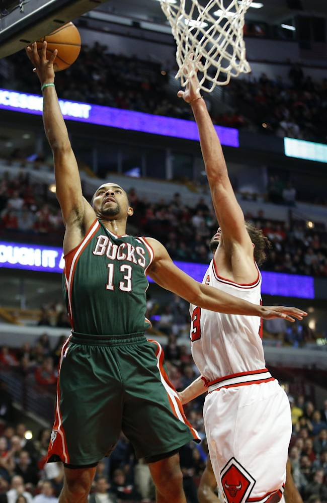Milwaukee Bucks guard Ramon Sessions, left, goes to the basket against Chicago Bulls center Joakim Noah during the second half of an NBA basketball game in Chicago, Friday, April 4, 2014. The Bulls won 102-90