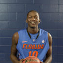 Florida's Dorian Finney-Smith (10) poses during The University of Florida's Basketball Media Day in Gainesville, Fla., Oct. 9, 2013. (AP Photo/Phil Sandlin)