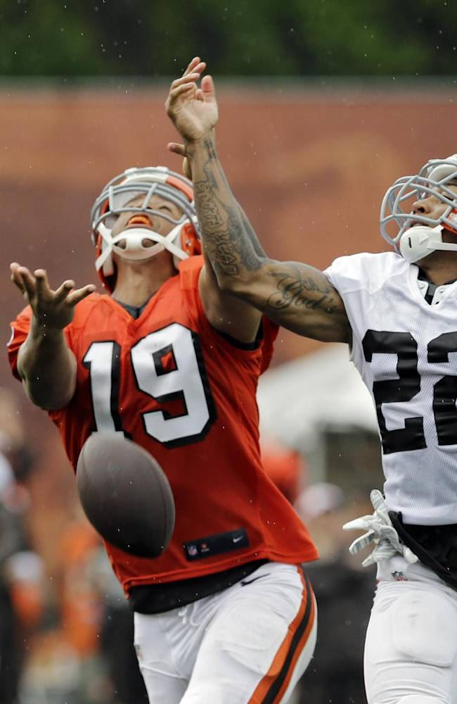 Cleveland Browns cornerback Buster Skrine (22) breaks up a pas intended for wide receiver Miles Austin (19) during practice at NFL football training camp in Berea, Ohio Monday, Aug. 11, 2014