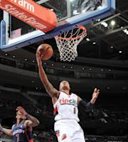 AUBURN HILLS, MI - DECEMBER 15: Damian Lillard #0 of the Portland Trail Blazers drives to the basket against the Detroit Pistons on December 15, 2013 at The Palace of Auburn Hills in Auburn Hills, Michigan. (Photo by Allen Einstein/NBAE via Getty Images)
