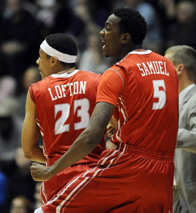 Illinois State's Zach Lofton, left, yells with Jamaal Samuel after scoring a three-point basket against Northwestern during the first half of an NCAA college basketball game in Evanston, Ill., on Sunday, Nov. 17, 2013