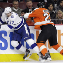 Tampa Bay Lightning's Alex Killorn, left, is hit by Philadelphia Flyers' Luke Schenn during the second period of an NHL hockey game, Monday, Jan. 12, 2015, in Philadelphia The Associated Press