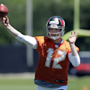 Tampa Bay Buccaneers quarterback Josh McCown throws to a receiver during a voluntary minicamp NFL football practice Wednesday, April 23, 2014, in Tampa, Fla The Associated Press