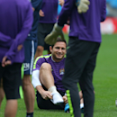 Manchester City's Frank Lampard adjusts his sock whilst taking part with other team members in a training session at the Etihad Stadium, Manchester, England, Monday Sept. 29, 2014. Manchester City face Roma in a Group E Champions League match on Tuesday