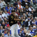 Pittsburgh Pirates third baseman Pedro Alvarez throws to first base to get the out on Chicago Cubs' Junior Lake during the sixth inning of a baseball game on Thursday, April 10, 2014, in Chicago The Associated Press
