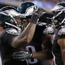Philadelphia Eagles wide receiver Arrelious Benn, left, celebrates with teammates after his touchdown catch on a pass from quarterback Mark Sanchez during first half of an NFL preseason football game against the New England Patriots Friday, Aug. 15, 2014,