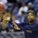 California guard Tierra Rogers passes a ball during practice at the Women's Final Four of the NCAA college basketball tournament, Saturday, April 6, 2013, in New Orleans. California plays Louisville in a national semifinal on Sunday. (AP Photo/Gerald Herbert)