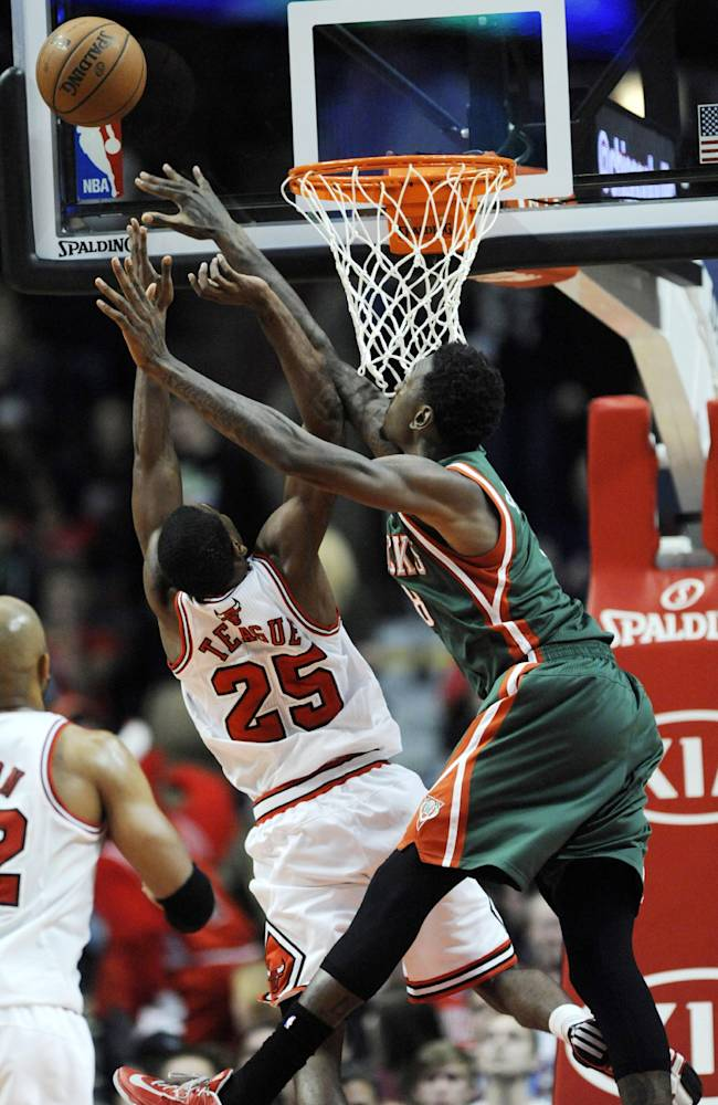 Chicago Bulls' Marquis Teague (25), goes up for a rebound against Milwaukee Bucks' Larry Sanders (8), during the first half of an NBA preseason basketball game in Chicago, Monday, Oct. 21, 2013