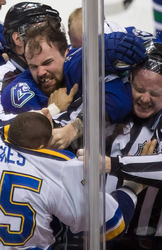 Canucks beat Blues 6-5 in shootout after blowing 3-goal lead