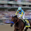 Victor Espinoza rides American Pharoah to victory in the 141st running of the Kentucky Derby horse race at Churchill Downs Saturday, May 2, 2015, in Louisville, Ky. (AP Photo/Tim Donnelly)