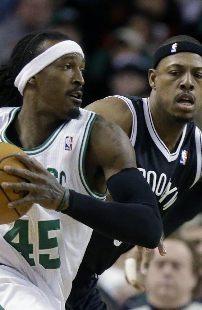 Boston Celtics forward Gerald Wallace (45), tries to drive past Brooklyn Nets forward Paul Pierce, center, in the first quarter of an NBA basketball game, Sunday, Jan. 26, 2014, in Boston. Celtics center Jared Sullinger looks on at right