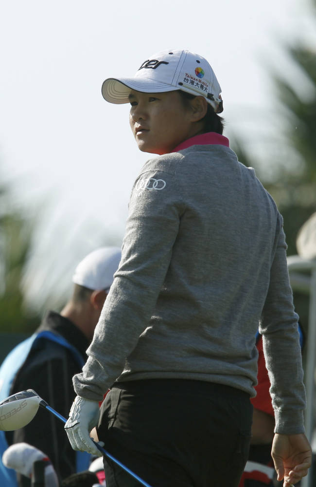 Yani Tseng of Taiwan, watches her ball after teeing off on the 10th hole during the last day of the LPGA Taiwan Championship tournament at the Sunrise Golf & Country Club, Sunday, Oct. 27, 2013, in Yangmei, northern Taiwan