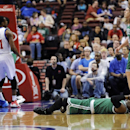 Boston Celtics' Rajon Rondo lays on the floor after getting injured during the first half of an NBA basketball game against the Philadelphia 76ers on Monday, April 14, 2014, in Philadelphia The Associated Press