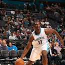 CHARLOTTE, NC - NOVEMBER 17: Noah Vonleh #11 of the Charlotte Hornets drives against the Dallas Mavericks during the game at the Time Warner Cable Arena on November 17, 2014 in Charlotte, North Carolina. (Photo by Brock Williams-Smith/NBAE via Getty Images)