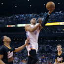 Oklahoma City Thunder guard Russell Westbrook (0) drives between Phoenix Suns' Channing Frye, left, and Goran Dragic, of Slovenia, during the first half of an NBA basketball game, Thursday, March 6, 2014, in Phoenix The Associated Press