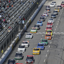 Joey Logano leads the field at the start of the NASCAR Truck race at Martinsville Speedway, Saturday, March 28, 2015, in Martinsville, Va. (AP Photo/Steve Helber)