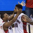 Toronto Raptors guard Kyle Lowry, left, celebrates with Amir Johnson after Johnson's basket against the Brooklyn Nets late in the second half of Game 2 in an NBA basketball first-round playoff series, Tuesday, April 22, 2014, in Toronto. Toronto won 100-95. (AP Photo/The Canadian Press, Nathan Denette)