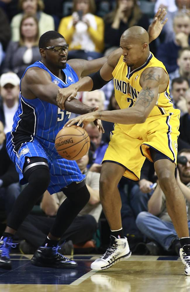 Orlando Magic center Jason Maxiell, left, and Indiana Pacers forward David West vie for control of the basketball in the first half of an NBA basketball game in Indianapolis, Tuesday, Oct. 29, 2013. The Pacers won 97-87