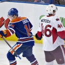Ottawa Senators' Patrick Wiercioch (46) skates past as Edmonton Oilers' Jordan Eberle (14) celebrate a goal during third period NHL hockey action in Edmonton, Alberta, on Tuesday March 4, 2014 The Associated Press