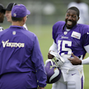 Minnesota Vikings wide receiver Greg Jennings (15) talks with head coach Mike Zimmer, left, during NFL football training camp, Sunday, July 27, 2014, in Mankato, Minn The Associated Press