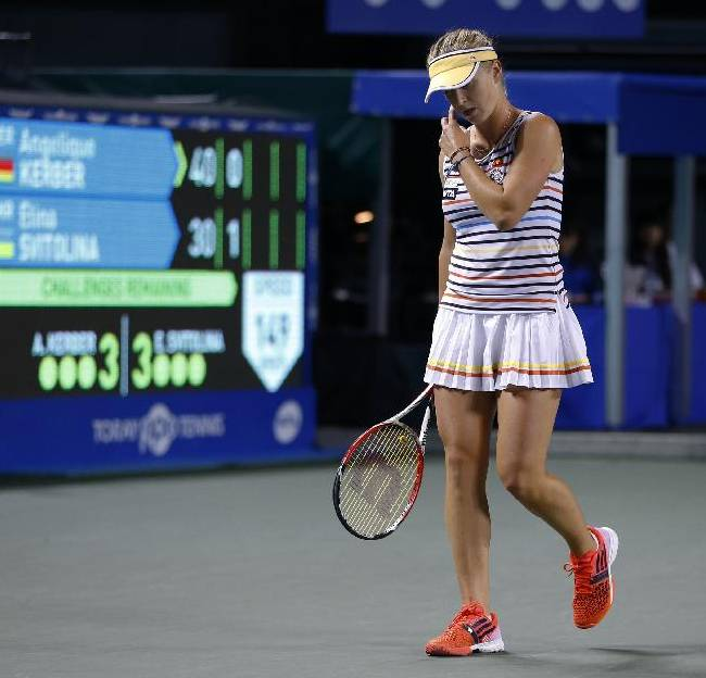 Elina Svitolina of Ukraine reacts after losing a point against Angelique Kerber of Germany during their second round match of the Japan Pan Pacific Open tennis tournament in Tokyo Wednesday, Sept.  17, 2014