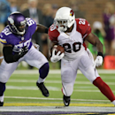 Arizona Cardinals running back Jonathan Dwyer (20) runs from Minnesota Vikings outside linebacker Gerald Hodges (50) during the first half of an NFL preseason football game, Saturday, Aug. 16, 2014, in Minneapolis The Associated Press