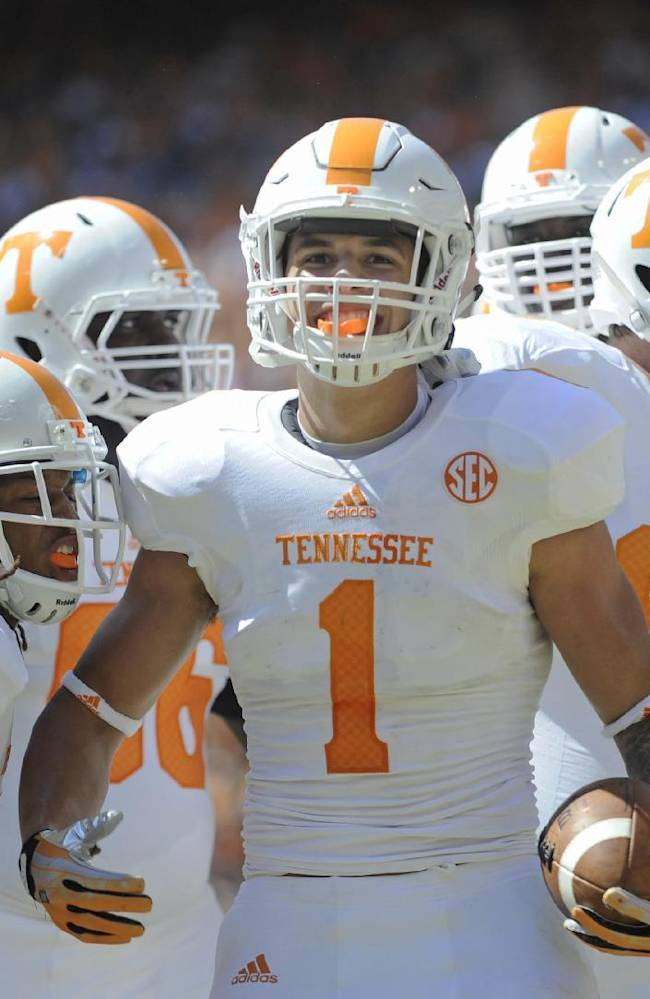 Tennessee running back Jalen Hurd (1) celebrates after scoring a touchdown during the first half of the Orange and White game at Neyland Stadium in Knoxville, Tenn., Saturday, April 12, 2014