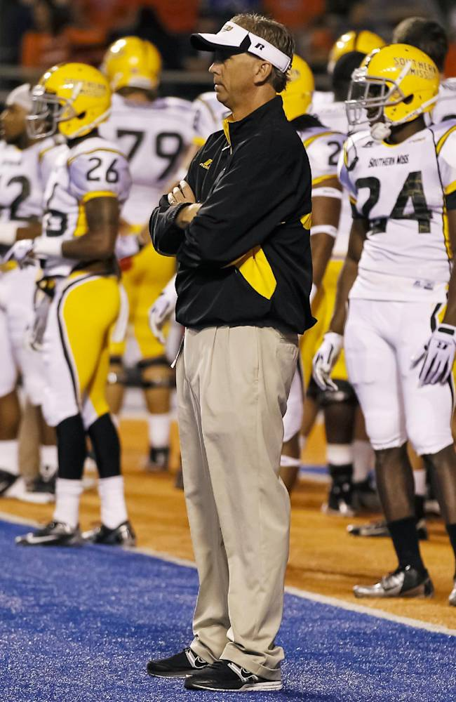 Southern Mississippi head coach Todd Monken looks on during warm-ups before an NCAA college football game against Boise State in Boise, Idaho, Saturday, Sept. 28, 2013