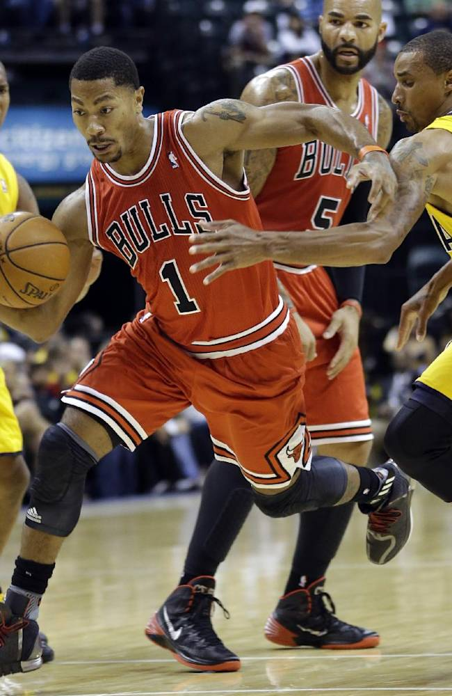 Chicago Bulls guard Derrick Rose, center, cuts between Indiana Pacers guard George Hill, right, and power forward David West, left, in the first half of an NBA preseason basketball game in Indianapolis, Saturday, Oct. 5, 2013