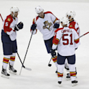 From left, Florida Panthers's Aaron Ekblad, Nick Bjugstad, Brian Campbell and Brandon Pirri celebrate Pirri's goal against the New Jersey Devils during the third period of an NHL hockey game, Saturday, Jan. 31, 2015, in Newark, N.J. The Devils won 3-1 The