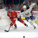 Carolina Hurricanes' Tim Gleason (6) and goalie Cam Ward (30) defend the goal against Buffalo Sabres' Mikhail Grigorenko (25), of Russia, during the first period of an NHL hockey game in Raleigh, N.C., Thursday, Jan. 8, 2015 The Associated Press