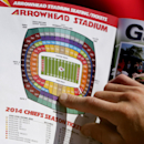 In this July 27, 2014, file photo, a fan looks at a season ticket seating map during NFL football practice at the Kansas City Chiefs' training camp in St. Joseph, Mo. By making fans feel as though they're part of the team, and offering gifts and experienc