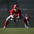Cincinnati Reds shortstop Zack Cozart fields a ground ball during baseball spring training Thursday, Feb. 20, 2014, in Goodyear, Ariz The Associated Press