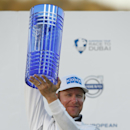 Mikko Ilonen of Finland holds up the World Match Play Championship trophy as he poses for photographers after defeating Henrik Stenson of Sweden in the final at the London Golf Club in Ash, England Sunday, Oct. 19, 2014. Ilonen won on the 17th hole 2 and 1 to play.(AP Photo/Alastair Grant)
