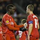 Liverpool's Mario Balotelli, left, takes the ball from captain Jordan Henderson before scoring a penalty during the Europa League Round of 32 soccer match between Liverpool and Besiktas at Anfield Stadium in Liverpool, England, Thursday, Feb. 19, 2015. (A