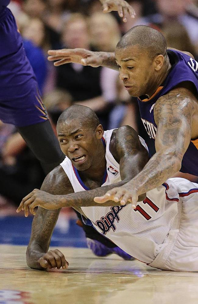 Los Angeles Clippers' Jamal Crawford (11) and Phoenix Suns' P.J. Tucker (17) go after the loose ball during the second half of an NBA basketball game on Monday, Dec. 30, 2013, in Los Angeles