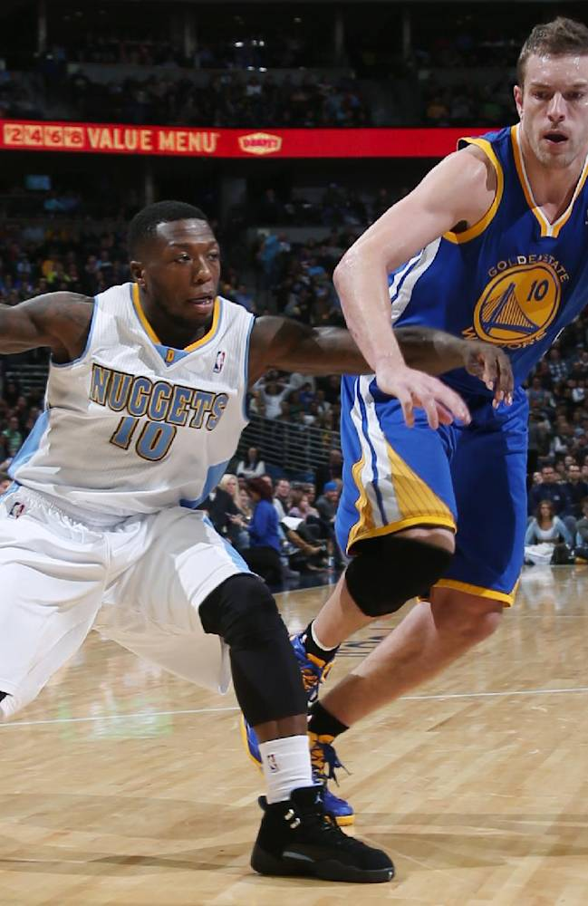 Denver Nuggets guard Nate Robinson, left, works ball inside as Golden State Warriors forward David Lee defends during the fourth quarter of the Warriors' 89-81 victory in an NBA basketball game in Denver on Monday, Dec. 23, 2013