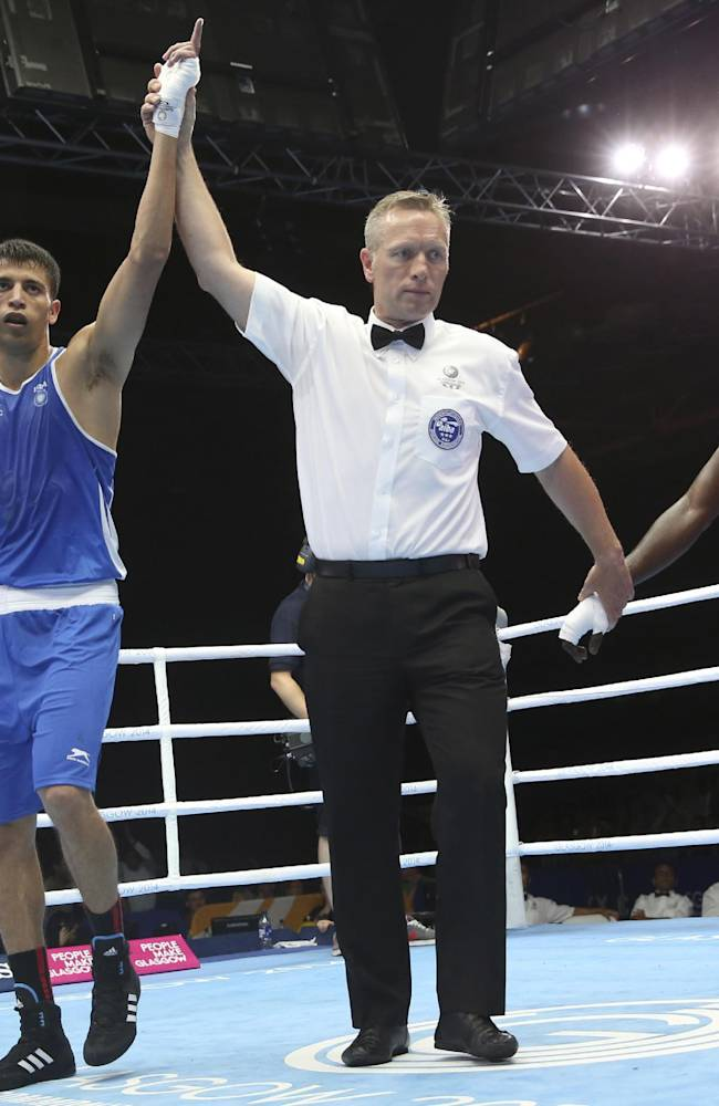 India's Sumit Sangwan, left, celebrates after defeating Tanzania's Mohamed Hakimu Fumu in their men's light heavywight boxing preliminary match at the Commonwealth Games Glasgow 2014, in Scotland, Sunday, July 27, 2014