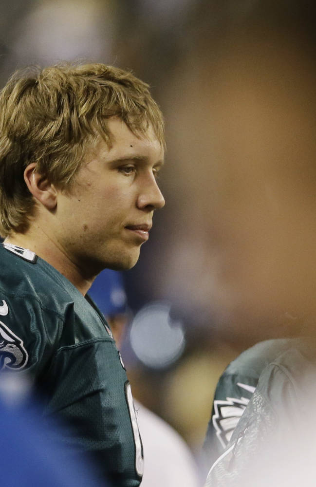 Philadelphia Eagles quarterback Nick Foles (9) pauses on the sideline after fumbling the ball against the Dallas Cowboys during the second half of an NFL football game, Sunday, Dec. 29, 2013, in Arlington, Texas