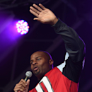 Atlanta Falcons defensive end Osi Umenyiora speaks on stage during the NFL Fan Rally in Trafalgar Square, London, England, Saturday, Oct. 25, 2014. The Atlanta Falcons will play the Detroit Lions in an NFL football game at London's Wembley Stadium on Sund