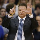 Kansas head coach Bill Self calls a play during the first half of an NCAA college basketball game against Texas in Lawrence, Kan., Saturday, Feb. 22, 2014. (AP Photo/Orlin Wagner)