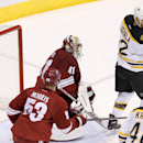 Boston Bruins' Jarome Iginla (12) redirects the puck past Phoenix Coyotes' Mike Smith (41) for a goal as Coyotes' Derek Morris (53) and Bruins' David Krejci (46), of the Czech Republic, watch during the third period of an NHL hockey game on Saturday, Marc