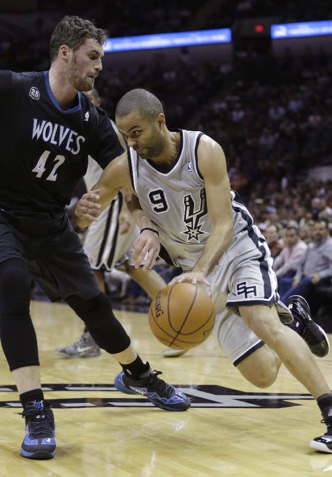 San Antonio Spurs' Tony Parker (9), of France, drives around Minnesota Timberwolves' Kevin Love (42) during the first half on an NBA basketball game, Sunday, Jan. 12, 2014, in San Antonio