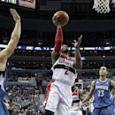 Washington Wizards guard John Wall (2) shoots in front of Minnesota Timberwolves guard Ricky Rubio (9), from Spain, and guard Kevin Martin (23) in the second half of an NBA basketball game Tuesday, Nov. 19, 2013, in Washington. The Wizards won 104-100. (AP Photo/Alex Brandon)