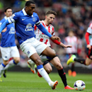 Sunderland's Fabio Borini, right, vies for the ball with Everton's Sylvain Distin, left, during their English Premier League soccer match at the Stadium of Light, Sunderland, England, Saturday, April 12, 2014