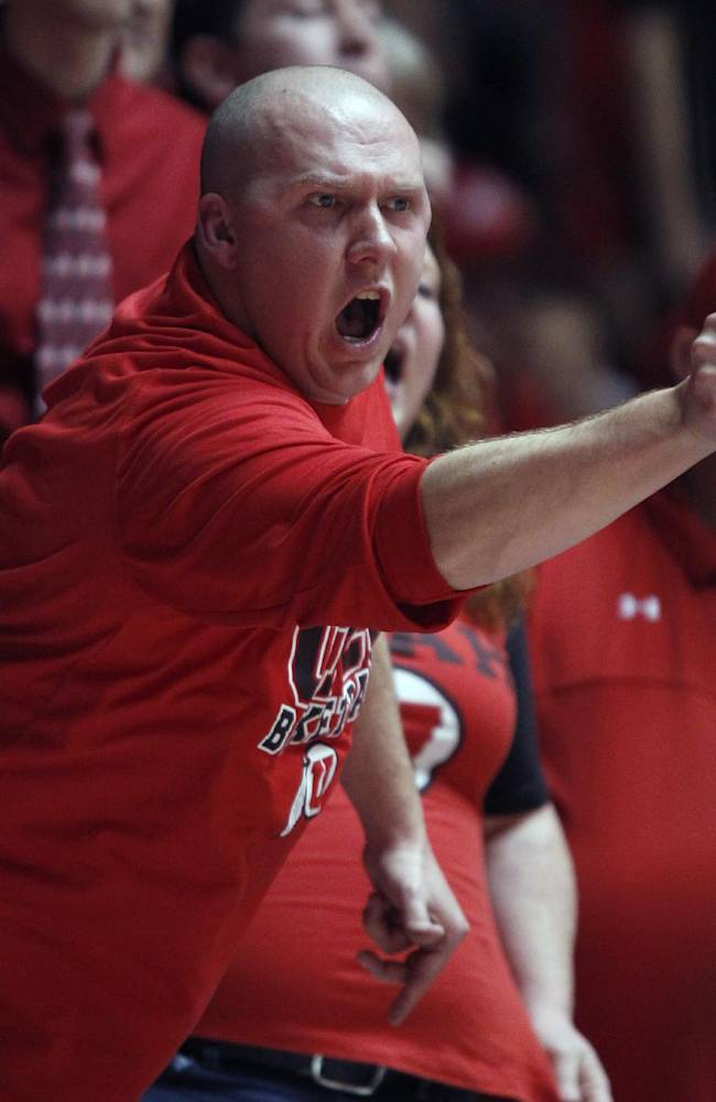 A Utah fan yells at an official during the second half of an NCAA college basketball game between Utah and Oregon in Salt Lake City, Thursday, Jan. 2, 2014. Oregon defeated Utah in overtime, 70-68. (AP photo/George Frey)