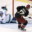 Phoenix Coyotes' Radim Vrbata (17), of the Czech Republic, scores against Vancouver Canucks' Roberto Luongo during the shootout in an NHL hockey game on Tuesday, Nov. 5, 2013, in Glendale, Ariz. The Coyotes defeated the Canucks 3-2 in a shootout The Asso