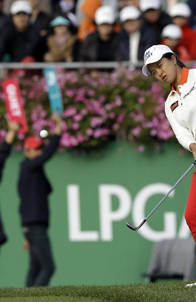 Sei Young Kim of South Korea watches her approach shot on the 18th hole during the final round of the KEB Hana Bank Championship golf tournament at Sky72 Golf Club in Incheon, west of Seoul, South Korea, Sunday, Oct. 20, 2013
