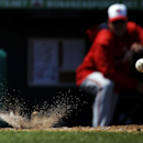 The ball bounces off the dirt on a ground out by Washington Nationals' Danny Espinosa in the sixth inning of an exhibition spring training baseball game against the St. Louis Cardinals, Wednesday, March 26, 2014, in Jupiter, Fla The Associated Press